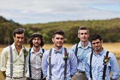 groomsmen in bow ties and suspenders