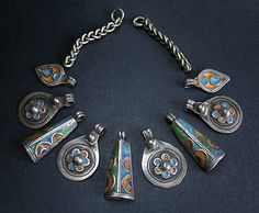 9 Enamel silver Berber pendants from an old Moroccan necklace | Contact Roger Casas, he is also on Pinterest http://pinterest.com/faqrun/
