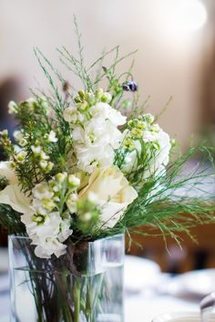 Beautiful floral arrangement at the reception  http://poppyandjune.com/2015/08/10/real-wedding-jack-pearl/