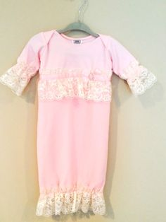 Sweet baby gown with pink chiffon overlay.  blueirisgiftboutique.com