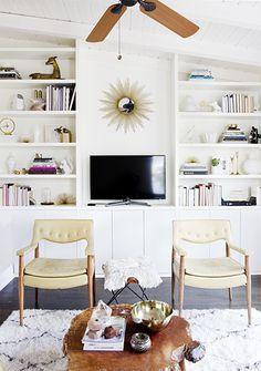 The Best Bright White Spaces// bookshelves, sunburst mirror, wood slab table, white living room