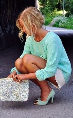 loose sweater with tight white skirt
