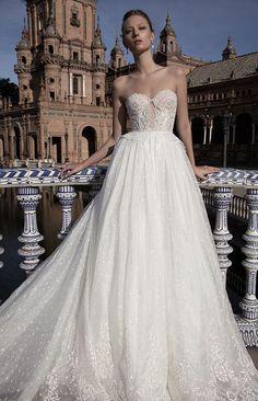 embellished strapless bodice ballgown wedding dress with empire waistline via alon livne