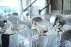 Simple table number on white linens.  Book your event today and customize everything to your liking! 219-945-0888