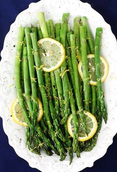 Simply Yummy Asparagus!! Preheat oven to 400 degrees F. Toss or mist the asparagus with olive oil and 1 Tbsp. lemon juice until evenly coated. Sprinkle with a pinch or two of sea salt, and then generously season with freshly-cracked black pepper. Roast for 8-12 minutes, or until the tips begin to brown and the asparagus is tender. Remove and garnish with lemon zest.