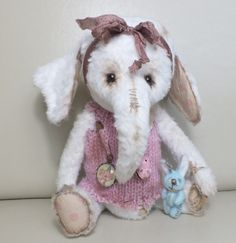 """Preshuss"" the baby elephant, with bunny toy, by Ragtail n Tickle."