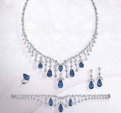 Four piece set at your disposal!!! Beautiful harmony of Diamonds and Blue Sapphires ! Absolute Stunner