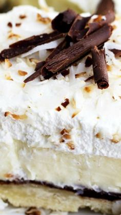 Chocolate Coconut Cream Pie Bars ~ This unforgettable dessert is layered with a shortbread crust, chocolate ganache layer, coconut cream, and topped with whipped cream!
