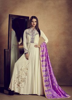 Charming cream embroidered gown suit online which is crafted from rayon  fabric with exclusive embroidery work. This stunning designer gown suit  comes with ... 4096999fc