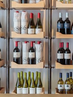 It's a wine lover's library: this shop in central Bucharest is designed to present wines as books, framing their labels against a post-industrial aesthetic of exposed wood and concrete.