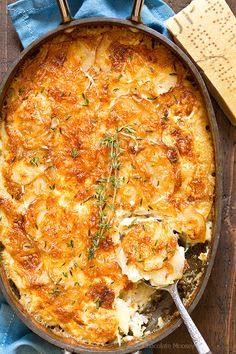 Plenty of cheesy goodness in Garlic Parmesan Au Gratin Potatoes with layers of thinly sliced potatoes, Parmesan cheese, and garlic. Serve it as a holiday side dish or alongside meat and potatoes for dinner.