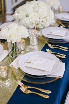 Beyond gorgeous place setting for a  formal wedding in navy blue, gold and ivory. The sparkly sequin runner is just enough glam without going overboard. And the gorgeous ivory roses keep the look classic and timeless.  CJ's Off the Square Nashville garden wedding and event venue Franklin, TN #formal