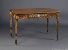 A Fine Louis XVI Style Gilt-Bronze Kingwood and Parquetry Inlaid Writing Table With Wedgwood Jasperware Plaques, By Joseph-Emmanuel Zwiener, French, Circa 1880.