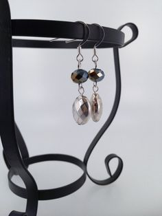 Faceted pewter dangle earrings with dark crystals.
