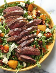 Salad For Dinner - Tasty Salad Recipes - ARUGULA SKIRT STEAK SALAD What doesn't sound good about this? Caramelized pears, candied pecans, chunks of gorgonzola, and juicy steak make for one seriously decadent salad.