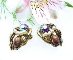 Antique Or Vintage Jewelry - Earrings A Loose Chignon Softens Your