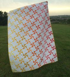 Hi and welcome to my pattern for the Ombre Pinwheels Quilt! I'm very excited to be here with you today to share this project. I originally made a version of this quilt a few years ago, using differ. Scrappy Quilts, Baby Quilts, Patchwork Quilting, Quilting Tutorials, Quilting Projects, Quilting Ideas, Sewing Projects, Ombre Fabric, Duvet