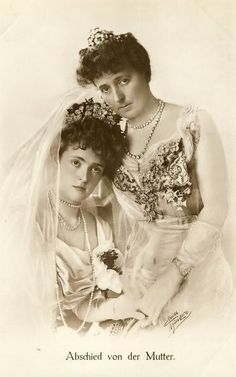 Duchess Marie Gabrielle of Bavaria on her wedding day, with her mother, Duchess Marie-Jose of Bavaria (nee Infanta of Braganca,)  Marie Gabrielle wears an unknown (to me) floral tiara, and her mother an equally unknown ornament.