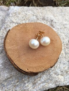 These classic and beautiful stud earrings are the perfect go-to item for versatile accessorizing! These earrings are handmade using genuine 10mm