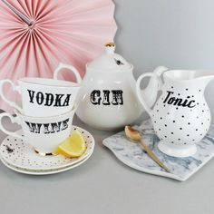 Unique and quirky bone china Boozy tea set for two with beautiful gilt gold detailing.A fun and fabulous set which is perfect for wowing guests at your dinner or tea parties, and is guaranteed to get the table talking and the party started. This one of a kind Vintage style set would also make a fantastic wedding gift or present for anyone who likes to have a little tipple in style. An original and unique piece of functional art, lovingly designed and made here in the UK using the finest…