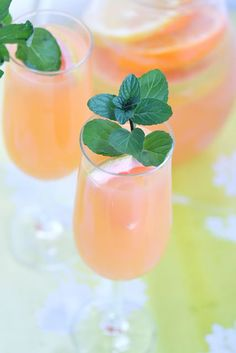 Citrus Sangria. 2 c Riesling wine, 2 c grapefruit juice, 1/2 c orange liquor, 2 c champagne, Fresh citrus slices such as lemons, oranges, grapefruit, clementine. Mix Riesling wine, grapefruit juice, orange liquor & citrus slices.  Refrigerate for at least 2 hrs. Serve by mixing in champagne & stir.  Pour sangria and garnish with fresh citrus slice and a sprig of mint.