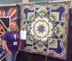 Glacier Star designed by Quiltworx.com, made by Cindy Simmons and quilted by Vicki Ruebel.  This quilt received a 2nd Place ribbon at the Quilting in the Falls Quilt Show!