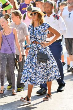 Jessica Alba wears a sunny Sam & Lavi poppy-print crop top and skirt, a panama hat, a python crossbody and black platform sandals