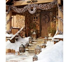 How can I make my home look like this in winter? Source lanterns from yard sales? Use huge rope to tie a wreath and garland above my door?   Briarwood Lanterns | Pottery Barn