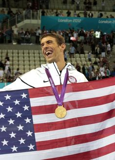 Gold Medallist Michael Phelps celebrates following the medal ceremony for the Men's 4 x 200m Freestyle Relay final on Day 4 of the London 2012 Olympic Games at the Aquatics Centre on July 31, 2012 in London, England. It was his record-breaking 19th Olympic medal.