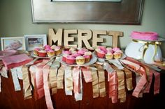 First Birthday Party - Golden Birthday - pink and gold - cupcakes - spray painted letters - fabric garland