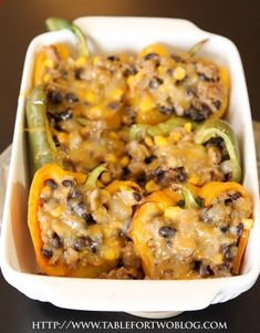 Corn and Black Bean Stuffed Peppers    Ingredients:  1/2 pound ground turkey,   1/2 large onion,  1 cup black beans,   1 cup frozen corn,  1 tbsp. taco seasoning (or sub for no wheat seasonings),  3 large bell peppers,  1 cup of shredded cheese (I used Monterrey jack)