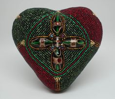 Pure of Heart. 3-D mixed media, 4.5″ high x 4.5″ wide x 2.5″ deep.