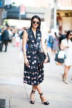 Eva Chen wearing a black Marc Jacobs swan print dress & Miu Miu glittwr sunglasses outside the Peter Som show #StreetStyle