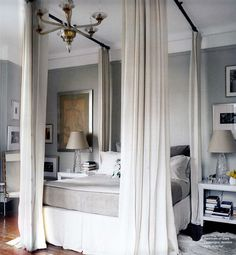 use curtain rods to create a canopy around bed... I need to do SOMETHING with our master bedroom... This could work