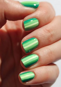 Go for the green with this ombre stripe nail art.