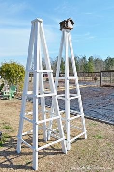 Wooden obelisks are great additions to your garden and are quite easy to make. #diy #garden #obelisk