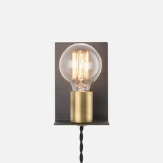 It's always nice to be reminded that good design doesn't have to cost an arm and a leg. We've scoured the web to find some seriously stylish lighting pieces for your home — all of which will set you back $100 or less.