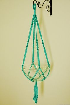Hand Crafted Macrame Plant Hanger- Turquoise by macramemarket on Etsy https://www.etsy.com/listing/101324807/hand-crafted-macrame-plant-hanger