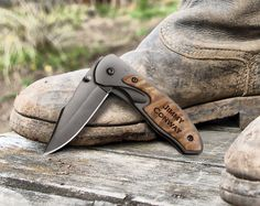 """A pocket knife is a must-have tool, both on the job and off. Great for around the house, in the garage, and out in the wild. Personalize with a name, business, or sentiment. Features a burl wood handle, pocket clip, and black 2.5"""" locking blade."""