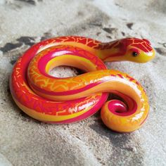 Fire Element Themed Snake. Handmade, Red and Orange Polymer Clay Reptile, Crafted by The Clay Kiosk on Etsy.