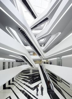 Its staircases appear to zig zag through the atrium, making the building resemble a spaceship rather than an office building. The futuristic space is quintessentially Hadid.