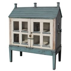Lovely victorian dollhouse cabinet. Nice design for a repro?