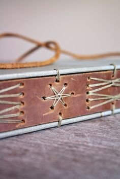 modified long stitch binding (does anyone know the original creator?)