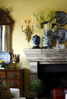 blue and white vignette - beautiful stone surround on the fireplace and pretty sconce in gold with all the blue and white Country Decor, Decor, Blue Decor, French Decor, Interior, Pinterest Living Room, White Decor, Blue And White, Home Decor