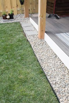 DIY rock landscaping around platform deck