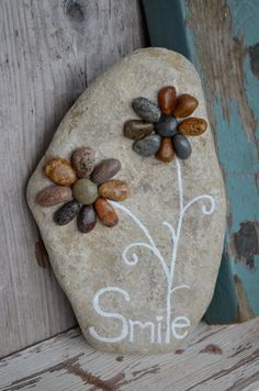 Smell the flowers rock art pebble art by BeachMemoriesByJools