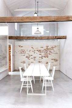 LOVE brick wall, wood beams, large framed work on left wall