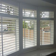 Wooden Venetian blinds bay window