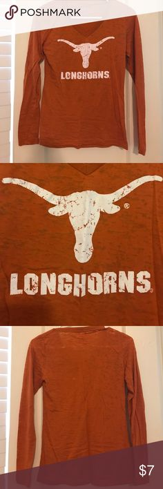 Burnt Orange Longhorns Fitted Long Sleeve Tee This long sleeve Longhorns Tee is perfect for those colder game days!! The logo is distressed. The shirt is slightly sheer so it is best worn with an under shirt. This Tee is in great condition! Hook 'em Horns!! 🤘🏼🤘🏼 Tops Tees - Long Sleeve