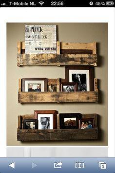 Foto's, decoratie aan de muur. Leuk voor in. Het trapgat